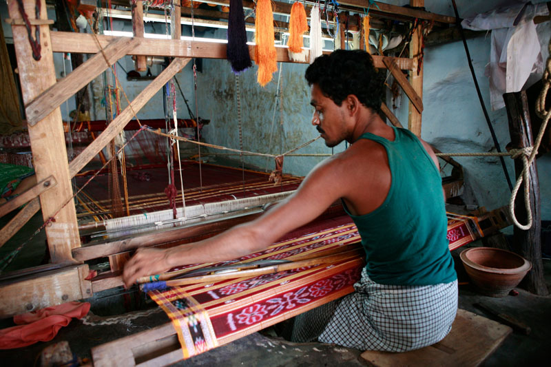 Man at loom weaving ikat, India