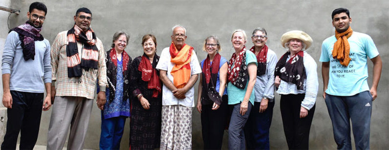 Previous travelers with silk scarves made in dye workshop with Master Ali M. Katri