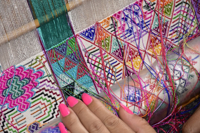 Complex weaving technique, typically used to make a wrap-dress in three panels.