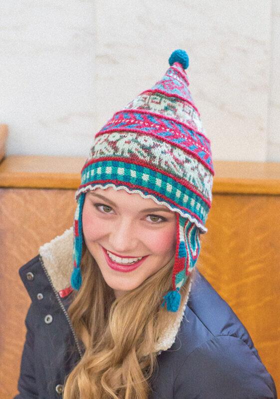 Model wearing handknit Andean-style cap.