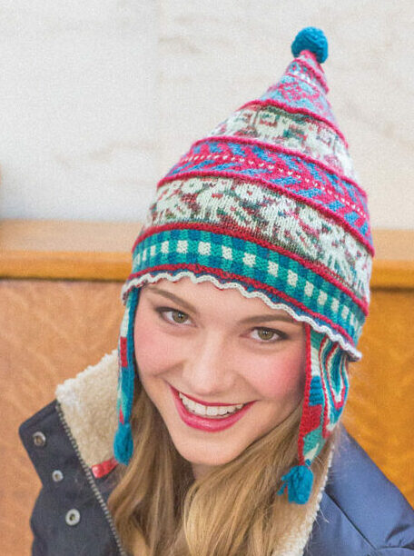Model wearing handknit Andean-style cap.