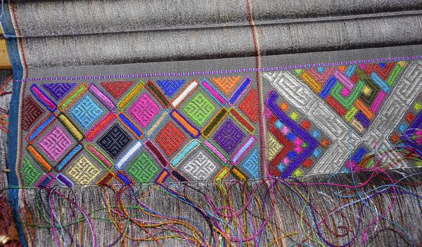 Weaving on loom in progress