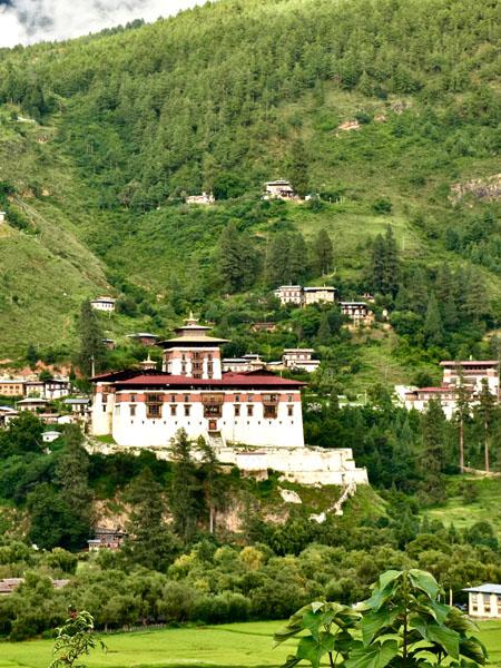 White house in Bhutan countryside.