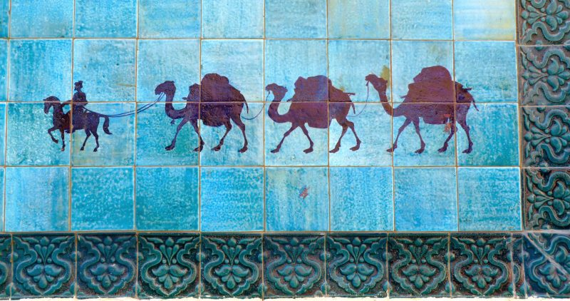 Camel parade painted on tiles by Joyce Carlson.