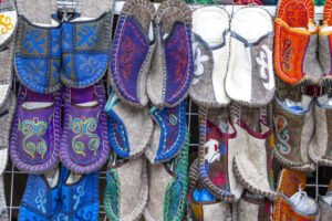 Shop display of felted slippers made of dyed wool, Kyrgyzstan.