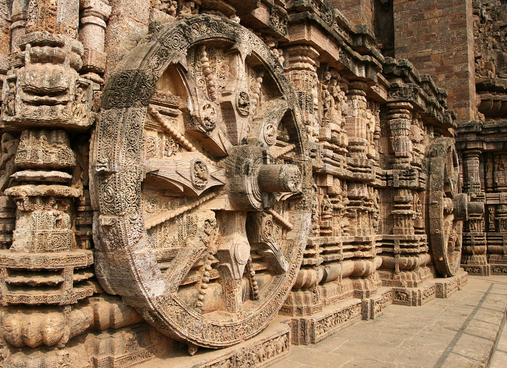 Intricate carvings on a stone wheel in the ancient Surya Hindu Temple at Konark, Orissa, India. 13th Century AD