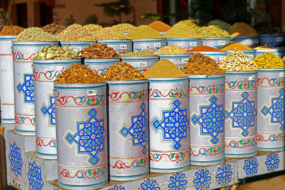 Decorated tins full of Moroccan cooking spices.
