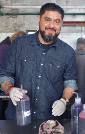 Gerardo Guzman dyes yarn.