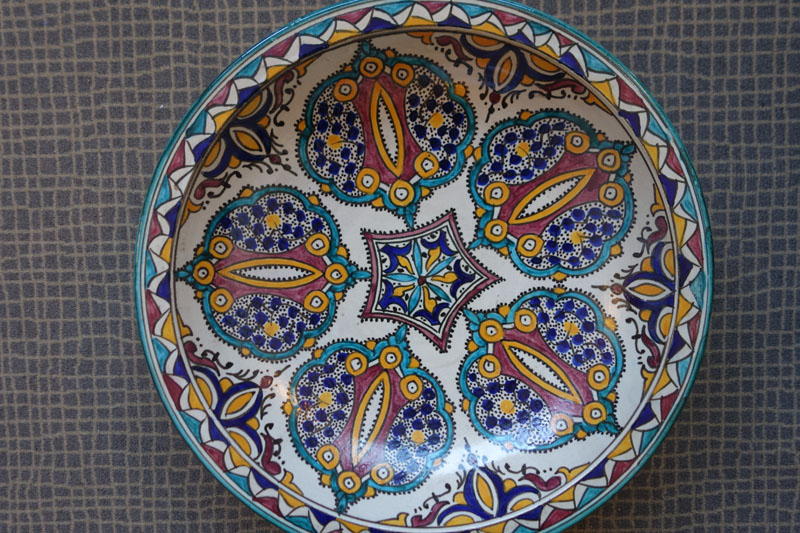 Example of hand-painted ceramic plate with traditional designs, from Fes potters.