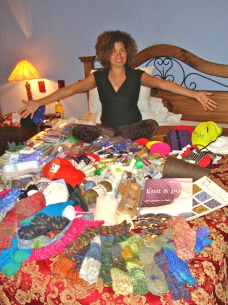 Claudia Avila, overjoyed at all the goodies donated for the remote Andean villages; Beverly's socks are in the foreground.