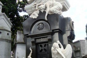 Marble angle sculptures on tomb in Recoleta Cemetary.; Buenos Aires.