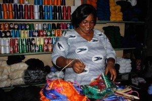 Woman selling kente weaving supplies, Ghana