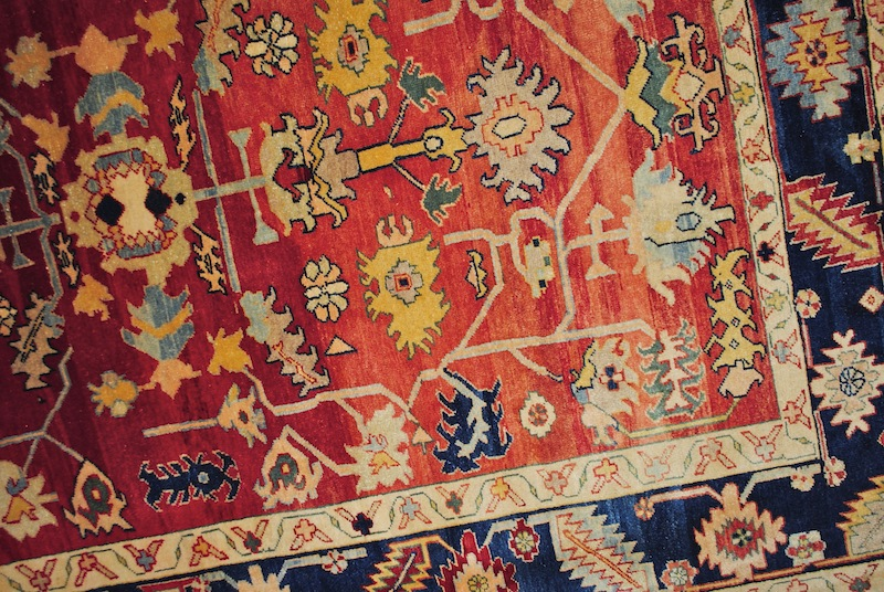 Carpet with red background and black border designs, Turkey.