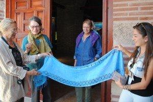 Zeynep admires Elsa's scarf.