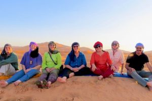 textile group on sand dunes in Morocco