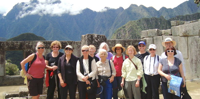 Group at Machu Picchu with Inca stones.