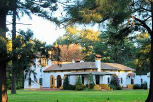 Country hacienda with tile roof, nestled among the trees near Buenos Aires.