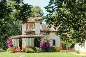Spanish style hacienda surrounded by trees and walking trails.