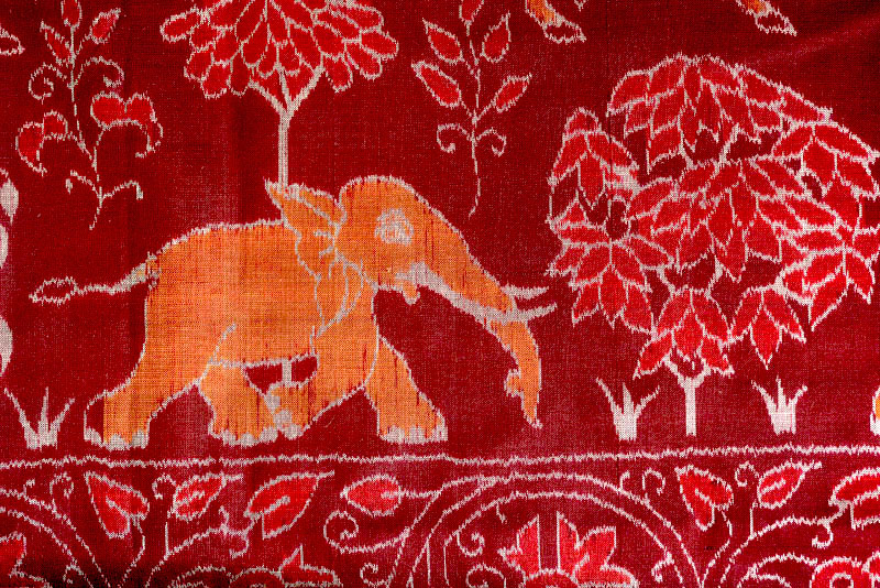 Ikat cloth with orange elephant