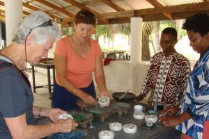 Bead-making with re-cycled glass in GHANA.
