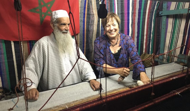 Traditional Muslim textile weaver with Cynthia, tour leader.