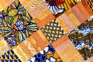 Yellow patchwork with cloth from Ghana.