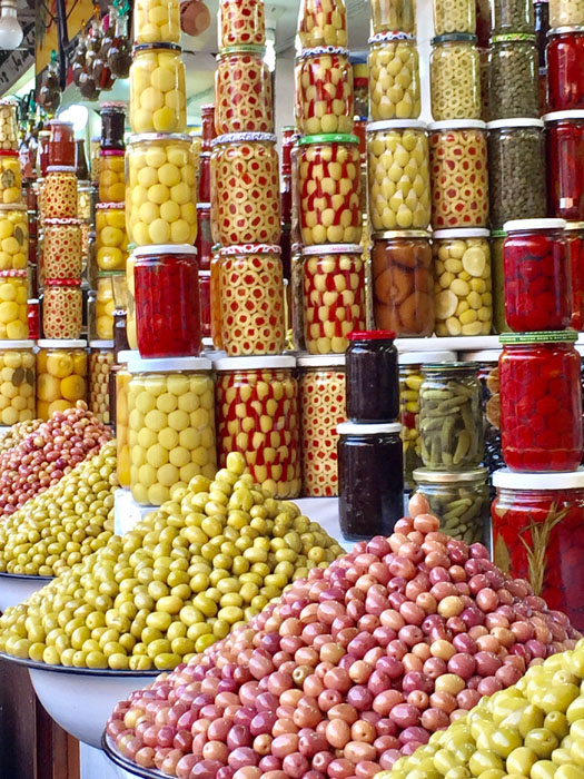 Market stall near Place Jemaa el Fnaa with fancy displays of olives.