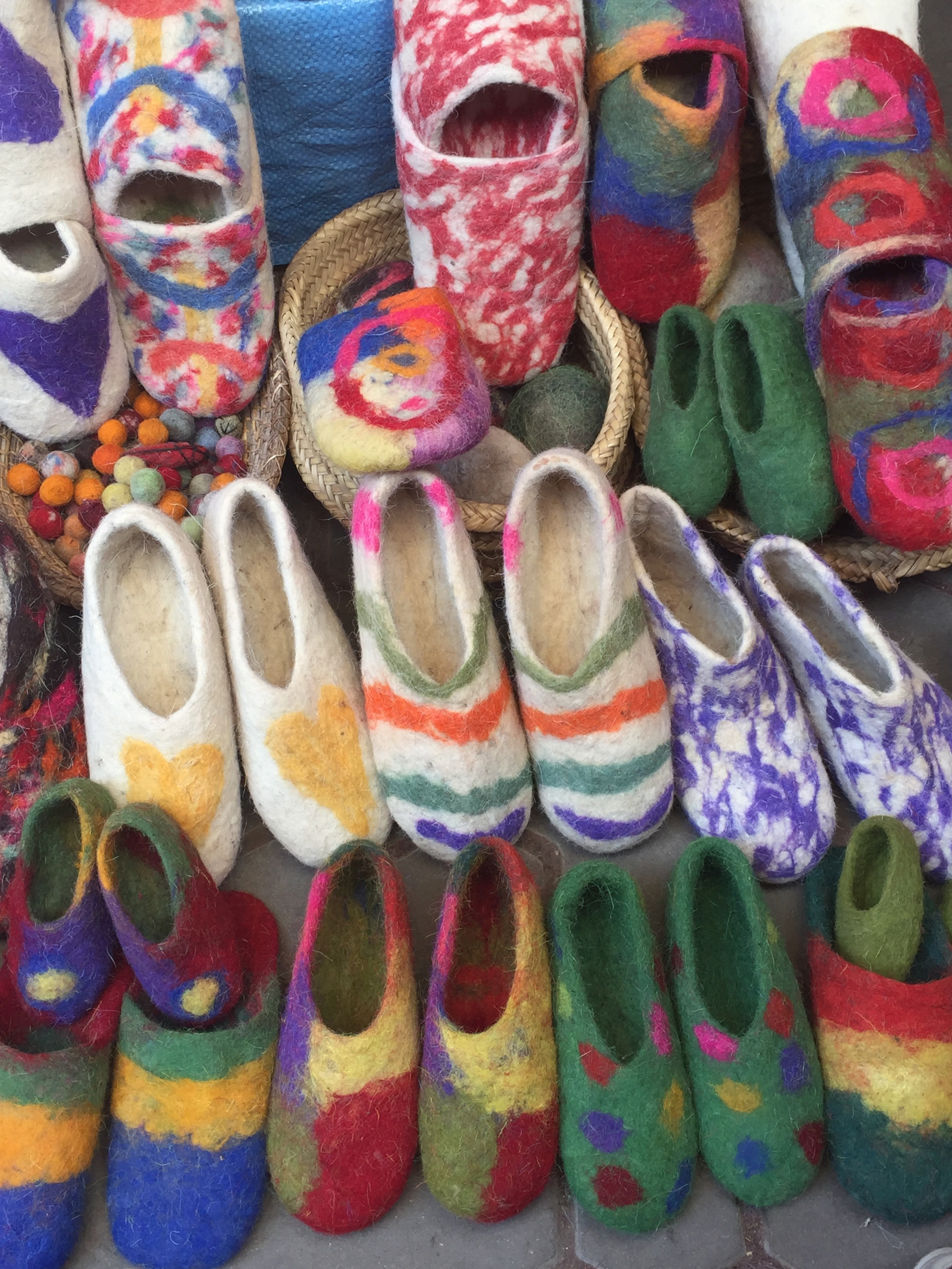 Modern felted slippers made of sheep's wool, in Fes medina souk.