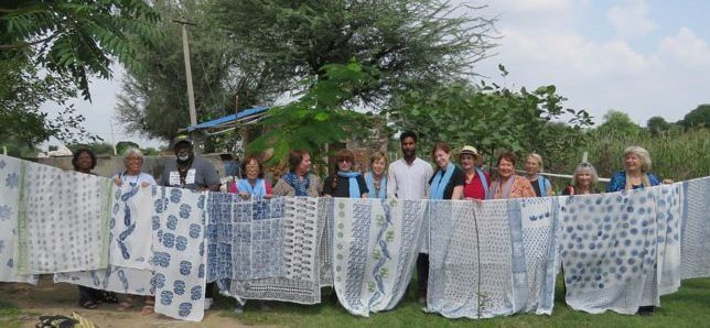Behind the Scenes group shows off hand-blocked scarves, with Deepak of BlockPrint House in the middle, Bagru, India.