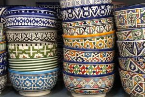 Stacks of hand-painted ceramic bowls.