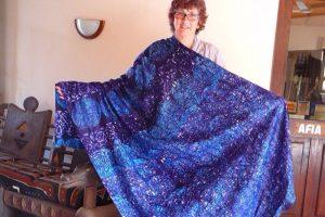 Ghana textile traveler with her blue batik cloth.