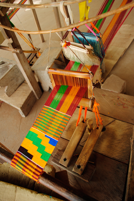 Ashanti Kente cloth in progress on strip loom.