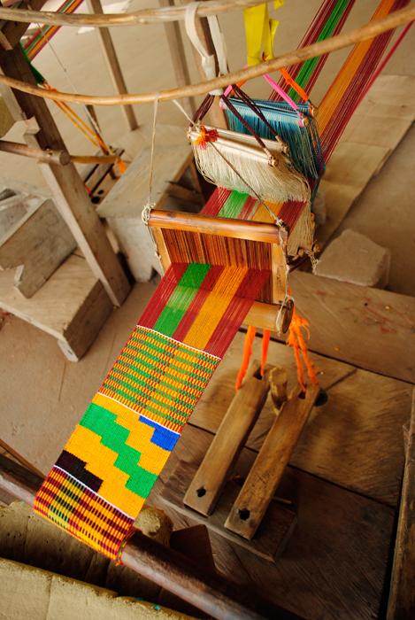 Ashanti Kente cloth in progress on strip loom.