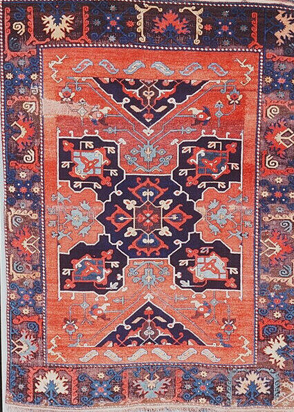Red and Navy USAK carpet from Metropolotan Museum, NYC. Creative Commons Zero license.