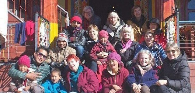 Northeast India textile tour group rests on the steps of the Nunnery in Tawang.