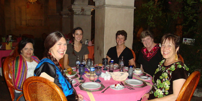 Oaxaca Mexico textile tour group of previous travelers, at farewell dinner.