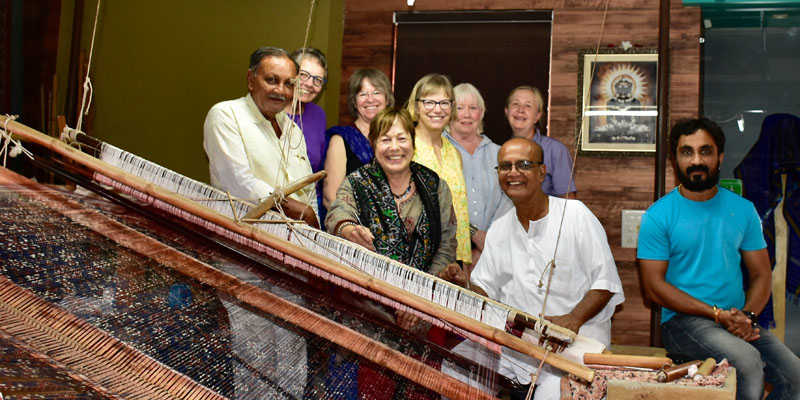Textile tour group with ikat weavers, India.