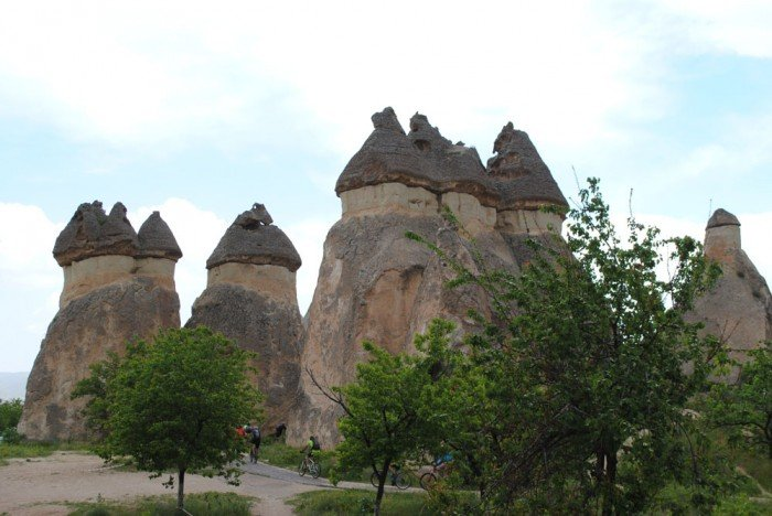 Eroded formations in Cappadocia; note tiny cyclists passing by.
