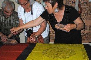 Cynthia block-printing her scarf.