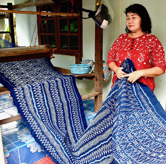 Blue handwoven cloth with varying weft patterns, in Thailand.