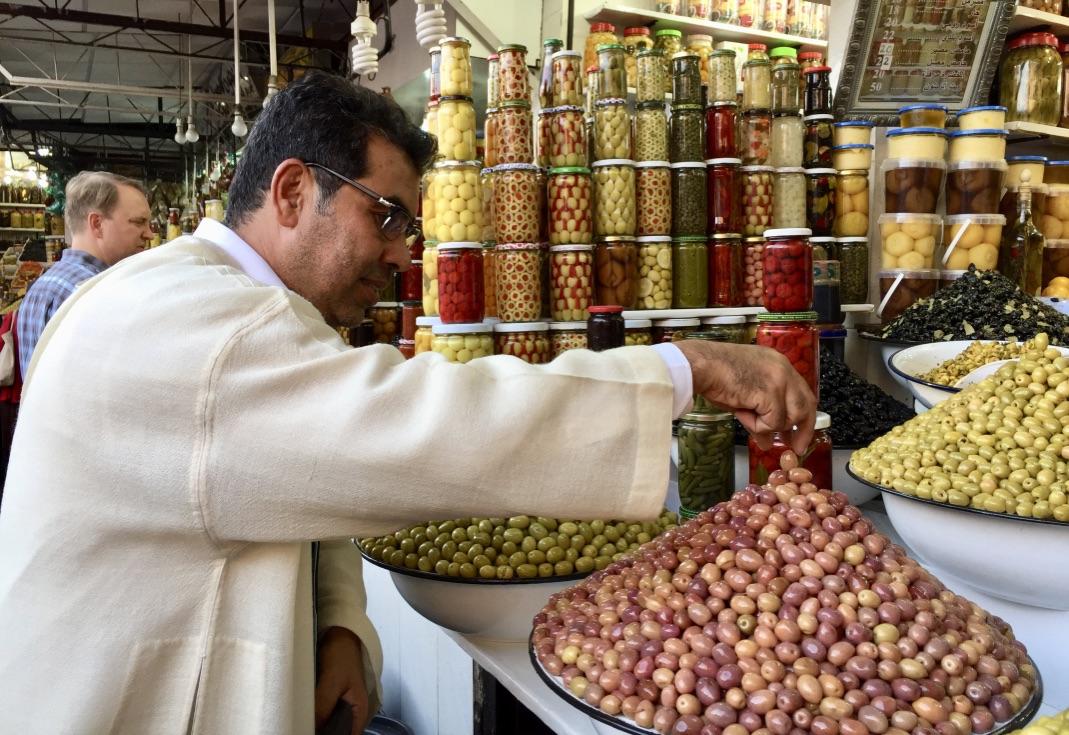 Ali tastes olives in Morocco